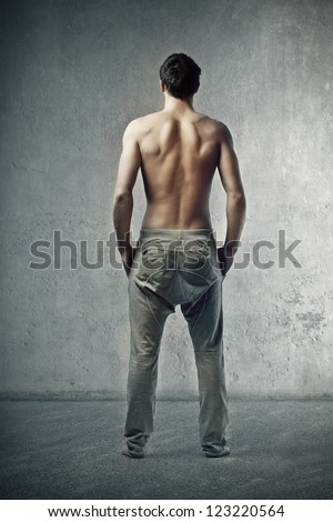 Shirtless back of a young man - stock photo