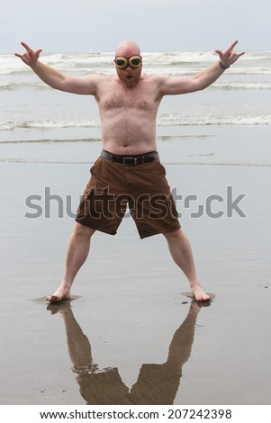 shirtless bald man at the beach - stock photo