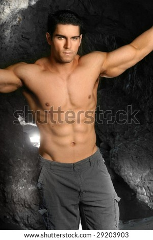 Shirtless bodybuilder with arms extended