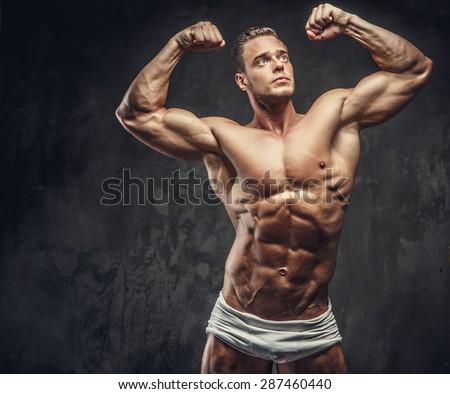 Shirtless guy in white panties showing his muscular body. - stock photo