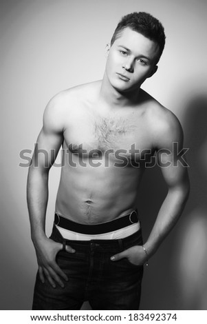 Shirtless handsome man with fit body indoor. Black and White