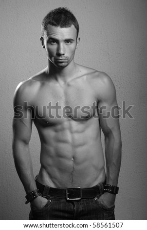Shirtless male model in studio - stock photo