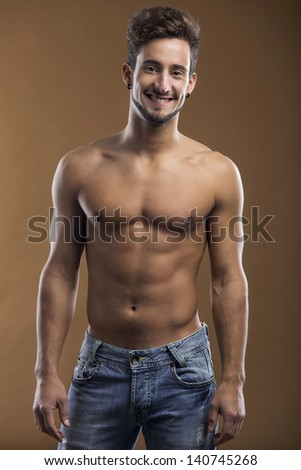 Shirtless male model smiling to the camera