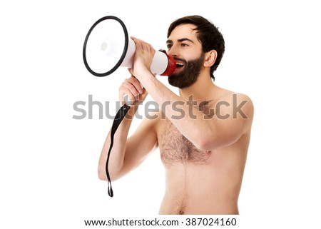 Shirtless man shouting using a megaphone. - stock photo
