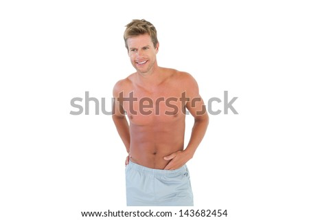 Shirtless man standing on white background