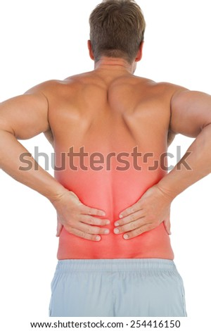 Shirtless man suffering from lower back pain on white background