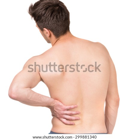 Shirtless man touching his back on white isolated background. Back view.