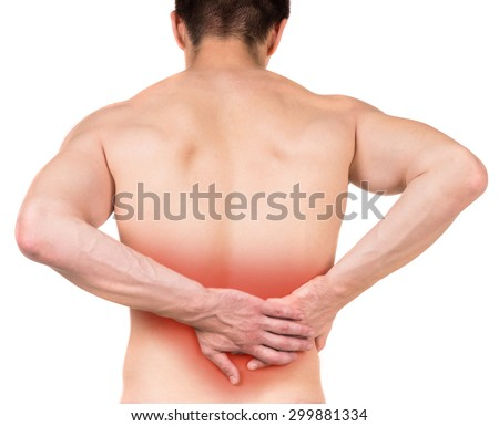 Shirtless man touching his back on white isolated background. Back view. Close-up.