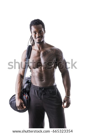 Shirtless muscular black young man with gym bag on shoulder, shot from behind in studio shot isolated on white