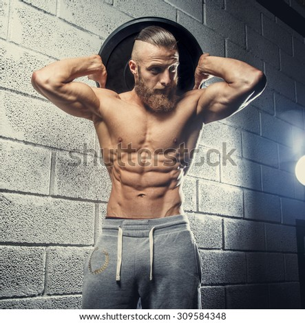 Shirtless muscular bodybuilder with beard