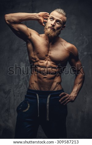 Shirtless muscular guy with beard showing his great body.