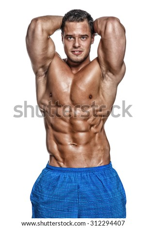 Shirtless muscular male in blue shorts isolated on white background.