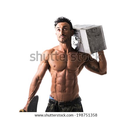 Shirtless muscular man with skateboard and big boombox radio (or ghetto blaster) - stock photo