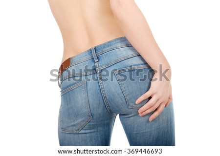 Shirtless woman alluring in jeans.