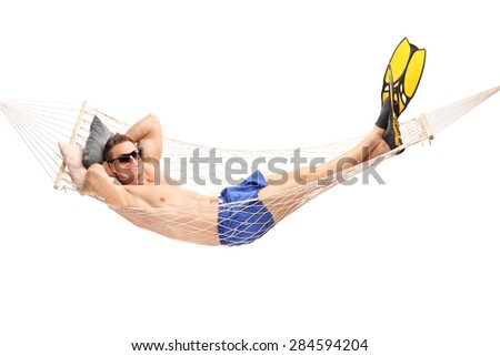 Shirtless young guy with diving flippers lying in a hammock and looking at the camera isolated on white background - stock photo