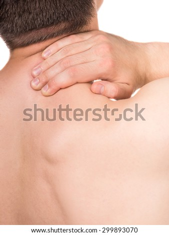 Shirtless young man suffering from neck pain on white background. Back view. - stock photo