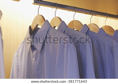 Shirts hanging in the closet