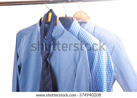 shirts on hangers, isolated on white background