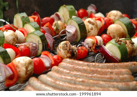 shish-kebab and sausages cooking on barbecue
