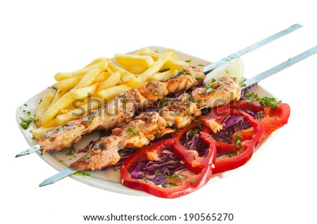 shish kebab on skewers with chips and red pepper pickled cabbage - stock photo