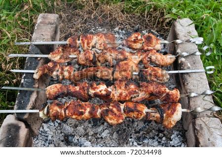 Shish kebab on the improvised oven made of brick - stock photo