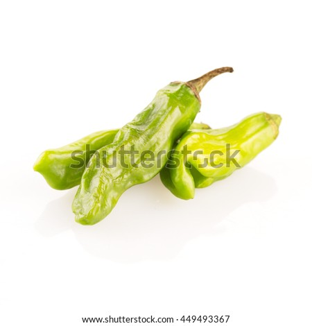 Shishito peppers isolated on a white background with shadow.