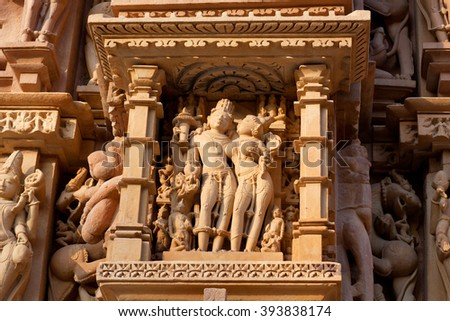 Shiva and Parvati - ancient bas-relief at famous erotic temple in Khajuraho, India. Most Khajuraho temples were built between 950 and 1050 by the Chandela dynasty.