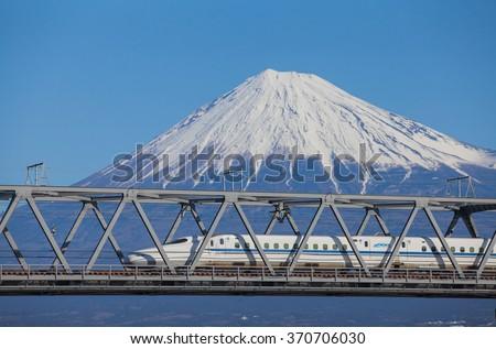 Shizuoka - JAN 13: Shinkansen bullet train and Mountain Fuji on JAN 13 ,2015 , Shizuoka ,Japan. Shinkansen is world's busiest high-speed railway operated by four Japan Railways companies.  - stock photo