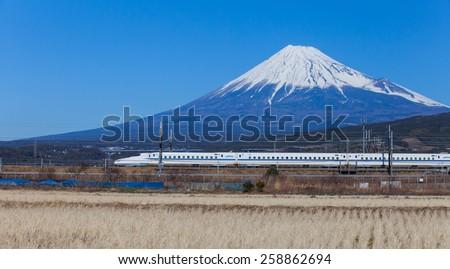 Shizuoka - JAN 13: Shinkansen bullet train at Tokyo railway station in JAN 13 ,2015 , Shizuoka ,Japan. Shinkansen is world's busiest high-speed railway operated by four Japan Railways companies.  - stock photo