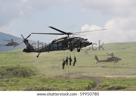 SHIZUOKA, JAPAN - AUGUST 28: Japanese Self Defense Force UH-60 Black Hawk during the Fire Power display near Mount Fuji August 28 2010 in Shizuoka, Japan.