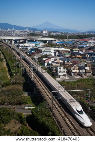 Shizuoka - OCT 08: Shinkansen bullet train and Mountain Fuji on OCT 08 ,2015 , Shizuoka ,Japan. Shinkansen is world's busiest high-speed railway operated by four Japan Railways companies.
