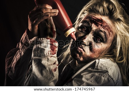 Shock horror food concept with a scary zombie woman out of tomato sauce at halloween party