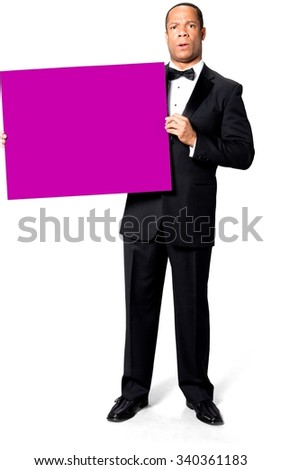 Shocked African man with short black hair in evening outfit holding large sign - Isolated