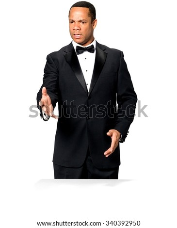 Shocked African man with short black hair in evening outfit offering handshake - Isolated