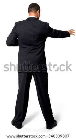 Shocked African man with short black hair in evening outfit reaching - Isolated