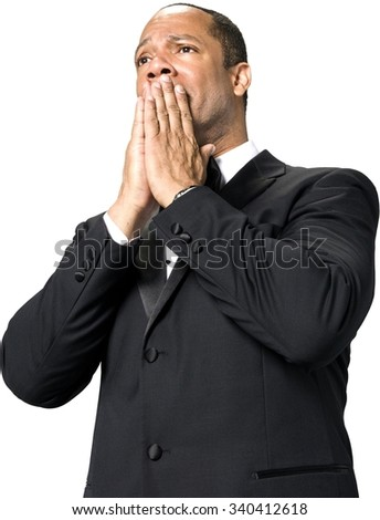 Shocked African man with short black hair in evening outfit with hands covering mouth - Isolated - stock photo