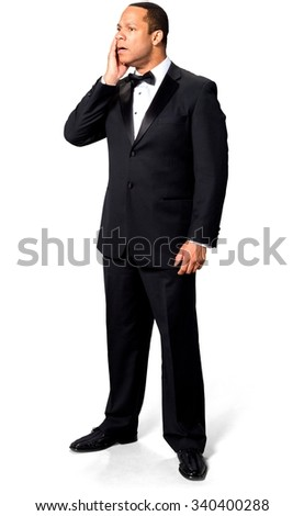 Shocked African man with short black hair in evening outfit with hands on face - Isolated - stock photo