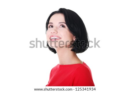 Shocked and excited woman looking up, isolated on white - stock photo