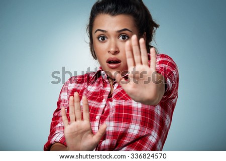 Shocked and frightened woman covering her body in surprsise and disbelief. - stock photo