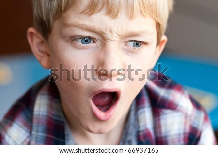 shocked and outraged little blonde boy