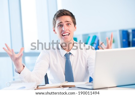 Shocked and stressed businessman - stock photo