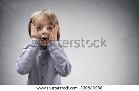 Shocked and surprised boy with copy space concept for amazement, astonishment, making a mistake, stunned and speechless or back to school - stock photo