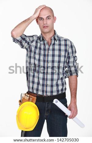Shocked bold builder - stock photo