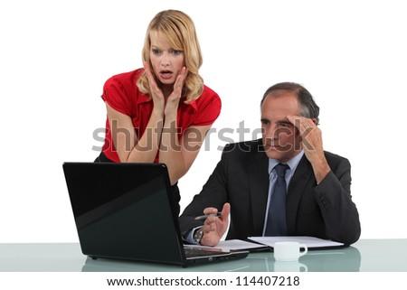 Shocked business partners - stock photo