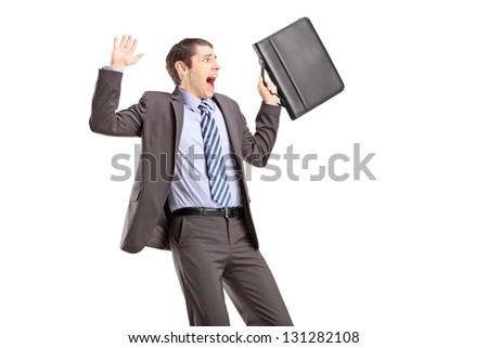 Shocked businessman gesturing fear - stock photo