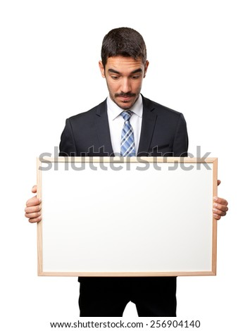 Shocked businessman holding a name card