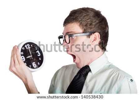 Shocked businessman looking at retro alarm clock, overdue concept on white background - stock photo