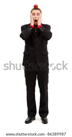 Shocked businessman with target apple on his head, looking surprised - stock photo