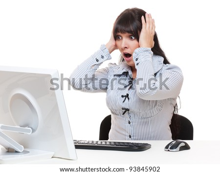 shocked businesswoman looking at monitor