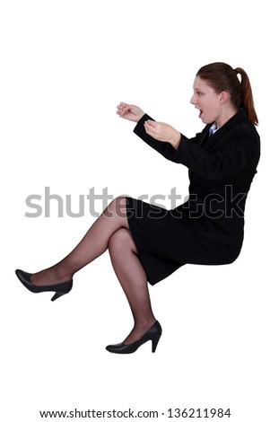 Shocked businesswoman reading an imaginary paper - stock photo